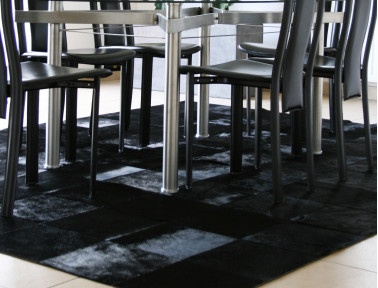 Patchwork rug in cowhide stained black