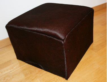 Stained cowhide pouf