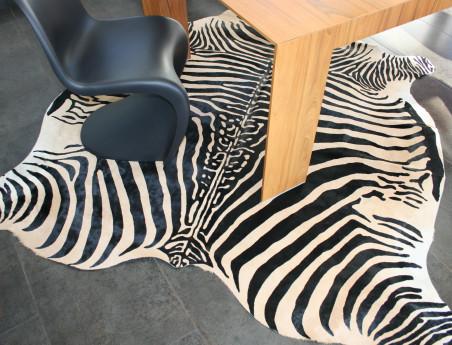 Zebra printed cowhide on beige background