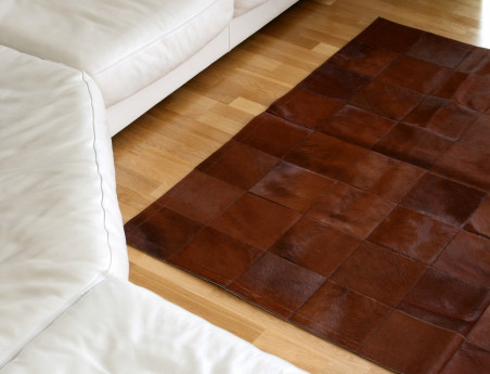 Patchwork rug in brown stained cowhide