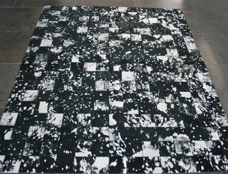 Patchwork rug in black cowhide