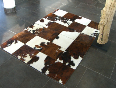 Patchwork rug in light Norman cowhide