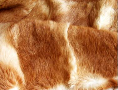Dessus de lit roux en fourrure de lapin