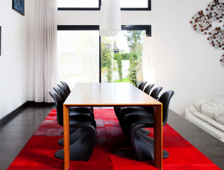 Patchwork rug in cowhide with red stain