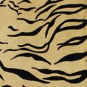 Peau de vache imprimée tigre sur fond beige